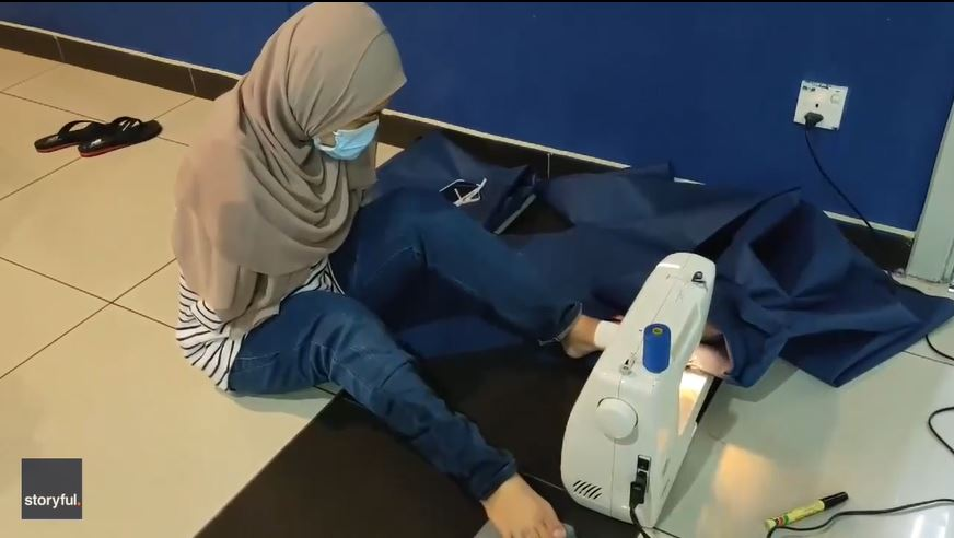 Malaysian Woman, Born Without Arms, Uses her Feet to Sew PPE for Frontline Workers